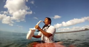 Reggie Padilla Plays Saxophone While Surfing