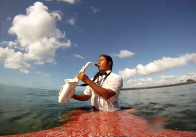 Reggie Padilla Plays Saxophone While Surfing