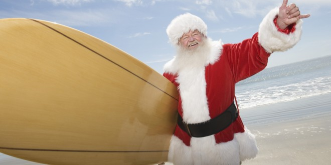 Santa Claus surfer